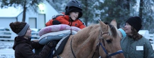 Our Adaptive Riding program builds strength and confidence in riders. And you can help!